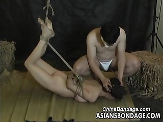 Asian slut is properly tied up by her man bdsm style